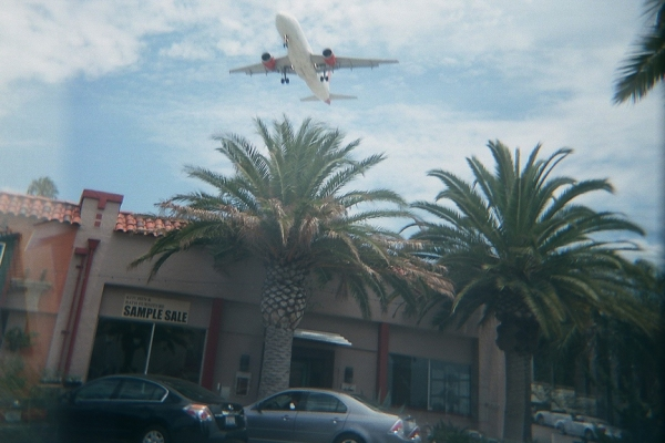 Airplane landing over Little Italy
