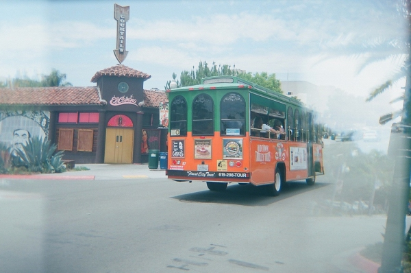 The Old Town Trolley rolls past El Camino on India Street